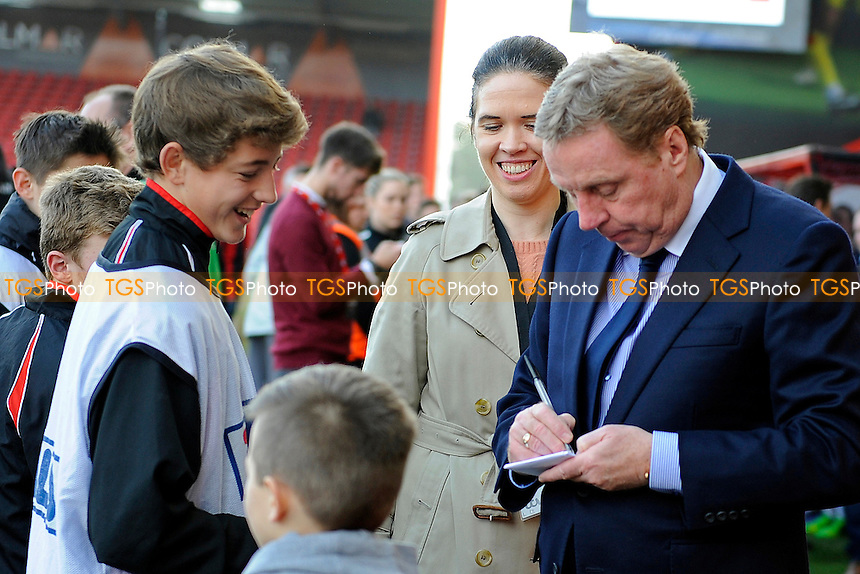 Harry Redknapp takes time out to sign autographs - AFC Bournemouth vs Liverpool - FA Cup 4th Round Football at the Goldsands Stadium, Bournemouth, Dorset - 25/01/14 - MANDATORY CREDIT: Denis Murphy/TGSPHOTO - Self billing applies where appropriate - 0845 094 6026 - contact@tgsphoto.co.uk - NO UNPAID USE