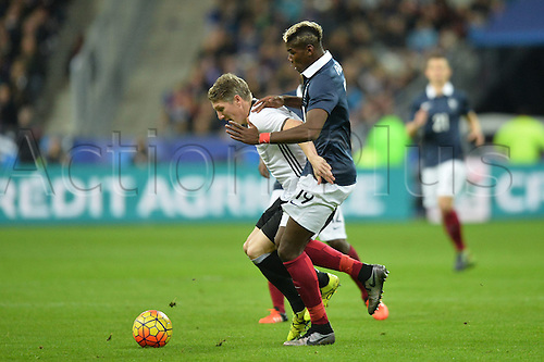 13.11.2015. Stade de France, Paris, France. International football friendly. France versus Germany.  PAUL POGBA - Bastian Schweinsteiger . The game was parially interupted as the paris terror attacks took place and bombs were heard going off outside the stadium.