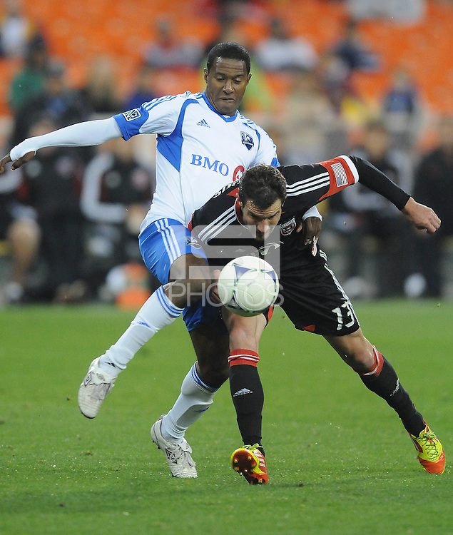 D.C. United forward Chris Pontius (13) gets fouled by Monteal Impact midfielder Patrice Bernier (8) D.C. United tied The Montreal Impact 1-1, at RFK Stadium, Wednesday April 18 , 2012.