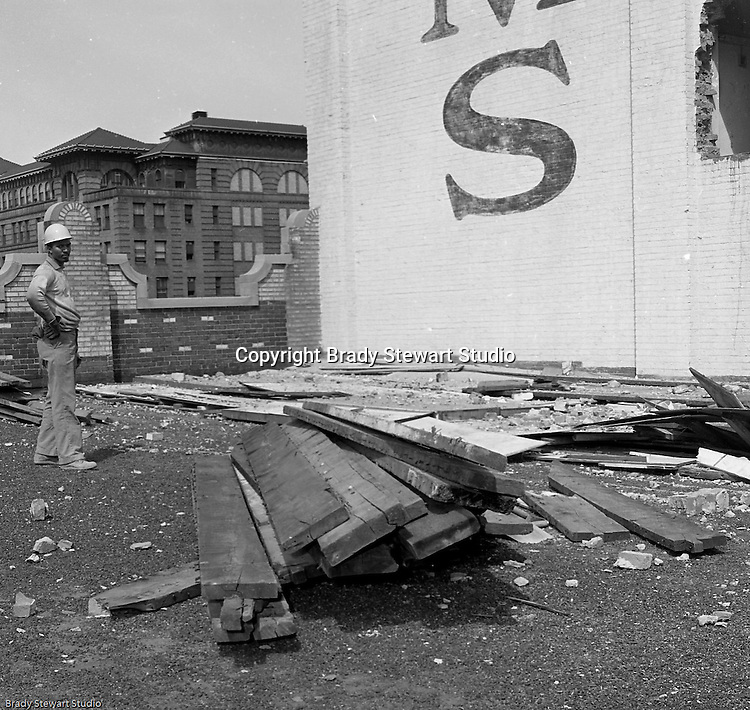 Pittsburgh PA:  View of foreman on roof during the demolition of one of downtown Pittsburgh's grand department stores, Rosenbaums. Located at Penn Avenue and Sixth Street in Pittsburgh, the store closed in 1960 and taken down in 1963 to make way for the Sixth Avenue garage.  The demolition work was completed by D&H Building Wreckers.