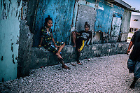 Young people 'hanging around' on the side of the street.