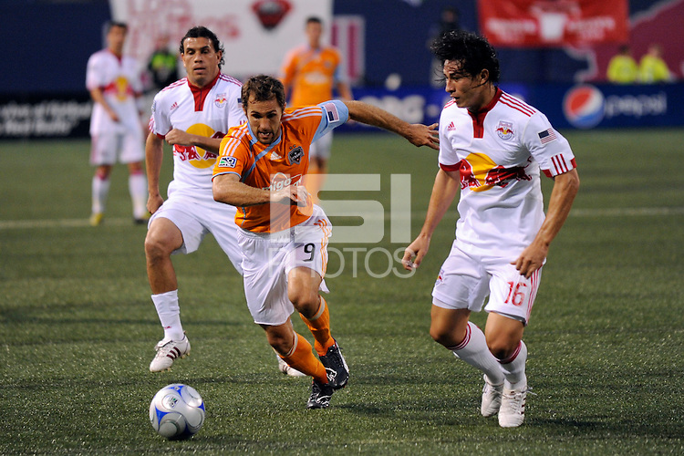 Brian Mullan (9) of the Houston Dynamo  and Alfredo Pacheco (16) of the New York Red Bulls. The New York Red Bulls and the Houston Dynamo played to a 1-1 tie during a Major League Soccer match at Giants Stadium in East Rutherford, NJ, on May 16, 2009.