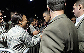 United States President Barack Obama greets military service personnel at Joint Base Pearl Harbor-Hickam in Honolulu, Hawaii as the first family arrived for their winter vacation on December 20, 2013.<br /> Credit: Cory Lum / Pool via CNP