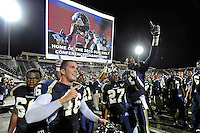 27 November 2010:  FIU's Chris Edwards (60), Michael Davies (46), Chuck Grace (21), Jose Cheeseborough (27) and Paul Crawford (92) celebrate winning the game and the Sun Belt Conference Championship after the FIU Golden Panthers defeated the Arkansas State Red Wolves, 31-24, at FIU Stadium in Miami, Florida.