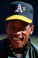 OAKLAND, CA - Rickey Henderson of the Oakland Athletics smiles while being interviewed before a game at the Oakland Coliseum in Oakland, California in 1990. Photo by Brad Mangin.