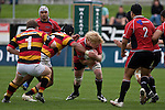 Jamie Chipman protects the ball as he is tackled by Faifili Levave. Air New Zealand Cup rugby game between Waikato & Counties Manukau, played at Rugby Park, Hamilton on Sunday 7th of August 2008.