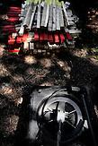 Die Werkzeuge zur Minenräumung hölzerne Pfähle und ein Metalldetektor / Wooden picktets prepared for mined areas and metal detector.