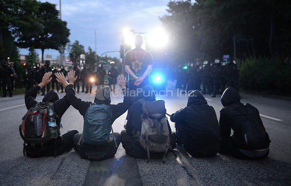 One of several police water cannons deployed against protestors during demonstrations against the G20 summit in Hamburg, Germany, 6 July 2017. Photo: Daniel Bockwoldt/dpa /MediaPunch ***FOR USA ONLY***