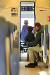 Young boy watching train driver on RENFE rail journey, Spain