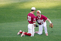 Indiana Hoosiers outfielder Casey Smith (20) and second baseman Chad Clark (29) get up after colliding into him during Game 9 of the 2013 Men's College World Series against the Oregon State Beavers on June 19, 2013 at TD Ameritrade Park in Omaha, Nebraska. The Beavers defeated the Hoosiers 1-0, eliminating Indiana from the tournament. (Andrew Woolley/Four Seam Images)