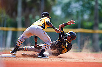 Pittsburgh Pirates Sandy Santos (22) slides into second as Pablo Reyes (68) applies the tag during an instructional league intrasquad black and gold game on September 18, 2015 at Pirate City in Bradenton, Florida.  (Mike Janes/Four Seam Images)