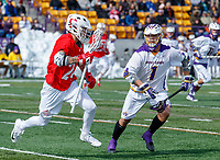 University at Albany Men's Lacrosse defeats Cornell 11-9 on Mar 4 at Casey Stadium. Tehoka Nanticoke (#1) challenges a Cornell midfielder.