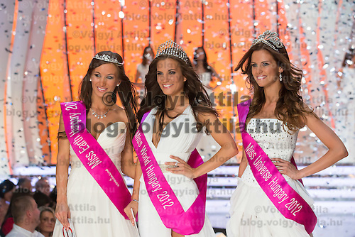 Newly crowned Miss World Hungary Tamara Cserhati (C) poses with runner-up and Miss Universe Hungary Agnes Konkoly (R) and Miss Earth Hungary Alexandra Kocsis after winning a joint beauty contest in Budapest June 9, 2012.