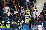 Stockholm 2014-09-05 Ishockey CHL Djurg&aring;rdens IF - Eisb&auml;ren Berlin :  <br /> Ordningsvakter och polis f&ouml;r bort en supporter under ett br&aring;k bland Djurg&aring;rdens  supportrar under matchen mellan Djurg&aring;rden och Eisb&auml;ren Berlin<br /> (Foto: Kenta J&ouml;nsson) Nyckelord:  Djurg&aring;rden Hockey Hovet CHL Eisb&auml;ren Berlin supporter fans publik supporters slagsm&aring;l br&aring;k fight fajt gruff