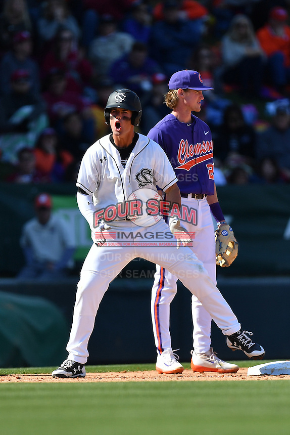 Right fielder Jacob Olson (7) of the South Carolina Gamecocks shouts after hitting a triple in the Reedy River Rivalry game against the Clemson Tigers on Saturday, March 4, 2017, at Fluor Field at the West End in Greenville, South Carolina. Clemson won, 8-7. (Tom Priddy/Four Seam Images)