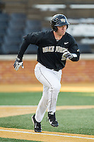 Ben Breazeale (9) of the Wake Forest Demon Deacons hustles down the first base line against the Georgetown Hoyas at Wake Forest Baseball Park on February 16, 2014 in Winston-Salem, North Carolina.  The Demon Deacons defeated the Hoyas 3-2.  (Brian Westerholt/Four Seam Images)