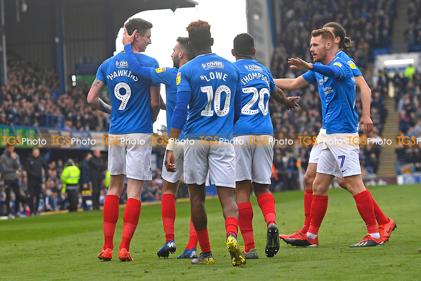 Old Hawkins left is mobbed after scoring the first goal during Portsmouth vs Rochdale, Sky Bet EFL League 1 Football at Fratton Park on 13th April 2019