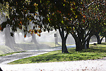 Sprinklers watering the lawn of the campus of the College of the Ozarks Branson Missouri