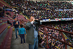 A spectator with a set of binoculars at half-time at the Stadio Giuseppe Meazza, also known as the San Siro, as Internationale took on Cagliari in an Italian Serie A fixture. The match was overshadowed by a huge controversy that as Inter Ultras declared open warfare on captain Mauro Icardi for a chapter in his autobiography, accusing him of lying about an incident in 2015. Inter Milan lost the match 2-1, watched by a crowd of 43,757.