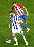 Atletico de Madrid's Yannick Ferreira Carrasco (r) and Real Sociedad's Inigo Martinez during La Liga match. April 4,2017. (ALTERPHOTOS/Acero)