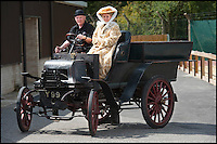 BNPS.co.uk (01202 558833)<br /> Pic: PhilYeomans/BNPS<br /> <br /> Here comes the bride....very slowly.<br /> <br /> Staff at the Haynes motor museum have dusted off what is thought to be Britains first wedding car, after the remarkable discovery in New Zealand of a 110 year old wedding snap.<br /> <br /> The museum's research has unearthed the Edwardian photograph of the old Daimler at the 1903 wedding between a Mr James Andrews and Miss Rosa Gough in Weston-Super-Mare - thought to be the first time a car was used for as wedding transport in Britain.<br /> <br /> The 1897 British built Daimler Wagonette dates from the very earliest days of motoring when the phrase 'Horseless carriage' was very apt. Its rudimentary 2 cylinder petrol engine only produced 6.5hp giving a top speed of only 11.6mph. <br /> <br /> The car featured cart wheels with solid tyres, a metal rod that functioned as a 'hand' brake, leather mud flaps and cart springs...and the brakes were rubber blocks that gripped the tyres.