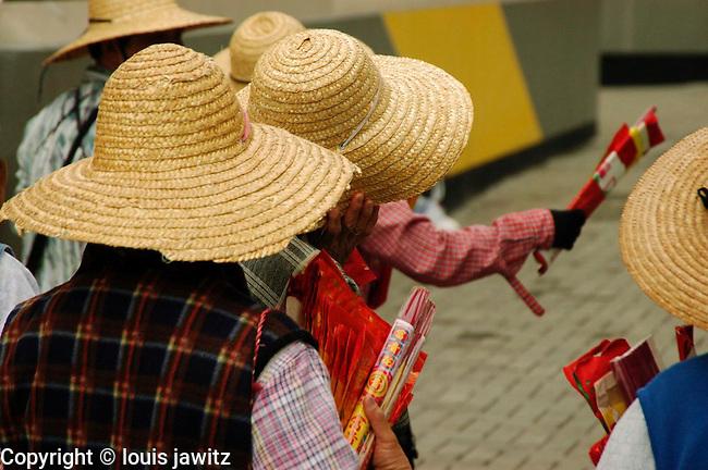 chinese ladies with hats  selling innocence at temple hong kong  china