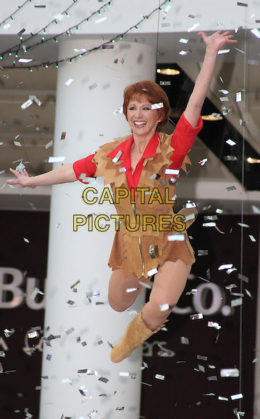 BONNIE LANGFORD .Photocall to launch the celebrity Pantomime productions from First Family Entertainment held at the O2 Centre NW3, London, England, .November 19th 2008..panto full length brown suede outfit costume red shirt boots posing jumping flying confetti funny posing .CAP/JIL.©Jill Mayhew/Capital Pictures