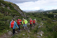 24-7-2014 Walkers pictured in Caherdaniel, County Kerry as they head off on the Kerry Way Cancer research Walk on Friday.<br /> Photo: Don MacMonagle<br />  <br /> Now in its 10th year the Kerry Way Cancer Research Walk is a fundraising event that has gone from strength to strength contributing over &euro;600,000 to Cork Cancer Research Centre helping researchers to translate lab discoveries into new cancer treatment opportunities for poor prognosis and incurable cancers. The three day walk along the scenic Kerry Way takes walkers from Caherdaniel, along the Kenmare River and finishing in the Killarney area on Sunday.<br /> Photo Don MacMonagle<br /> <br /> Repro free photo from Kerry Cancer Research.