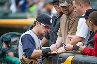 Scooter Gennett (5) of the Colorado Springs Sky Sox signs autographs before the game against the Salt Lake Bees in Pacific Coast League action at Smith's Ballpark on May 24, 2015 in Salt Lake City, Utah.  (Stephen Smith/Four Seam Images)