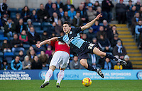 Luke O'Nien of Wycombe Wanderers goes in for the ball during the Sky Bet League 2 match between Wycombe Wanderers and Crawley Town at Adams Park, High Wycombe, England on 28 December 2015. Photo by Andy Rowland / PRiME Media Images