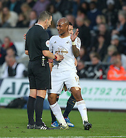 Andre Ayew of Swansea City gestures to referee Kevin Friend during the Barclays Premier League match between Swansea City and Arsenal played at The Liberty Stadium, Swansea on October 31st 2015