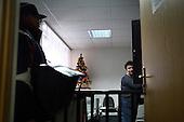 Jacek Serkiew, 60-years old Polish postman at the school, where he just delivered letters. It's winter and he works in snow covered Piaseczno in central Poland. Jacek is celebrating 40-th anniversary of his work as a postman..January 2010.(Photo by Piotr Malecki / Napo Images)..Praca listonosza. Jacek Serkiew w szkole gdzie doreczyl listy. Jacek wlasnie obchodzi czterdziestolecie pracy na tym stanowisku. .Piaseczno, Styczen 2010.(Fot: Piotr Malecki / Napo Images) ...
