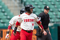 Fresno Grizzlies left fielder Yadiel Hernandez (13) after scoring the game-winning run during a game against the Reno Aces at Chukchansi Park on April 8, 2019 in Fresno, California. Fresno defeated Reno 7-6. (Zachary Lucy/Four Seam Images)