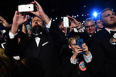 Supporters photograph United States President Donald Trump and First Lady Melania Trump at the Freedom Ball on January 20, 2017 in Washington, D.C. Trump will attend a series of balls to cap his Inauguration day.     <br /> Credit: Kevin Dietsch / Pool via CNP