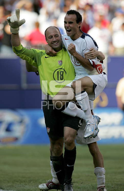 July 24, 2005: East Rutherford, NJ, USA:  USMNT goalkeeper and captain Kasey Keller  celebrates with teammate Landon Donovan (10) after winning the CONCACAF Gold Cup at Giants Stadium by defeating Panama on penalty kicks.