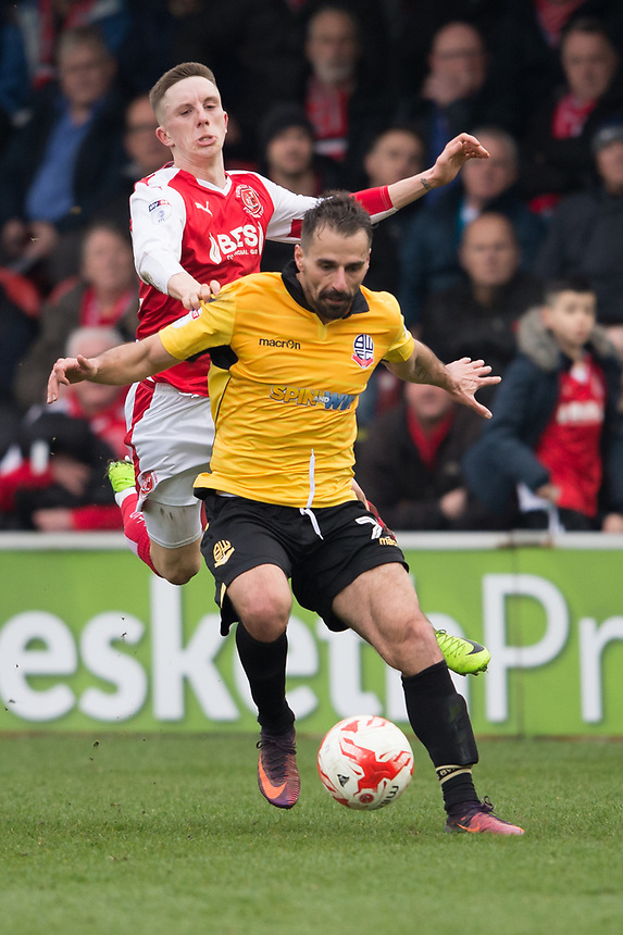 Fleetwood Town's Ashley Hunter battles with Bolton Wanderers' Filipe Morais<br /> <br /> Photographer Terry Donnelly/CameraSport<br /> <br /> The EFL Sky Bet League One - Fleetwood Town v Bolton Wanderers - Saturday 11th March 2017 - Highbury Stadium - Fleetwood<br /> <br /> World Copyright &copy; 2017 CameraSport. All rights reserved. 43 Linden Ave. Countesthorpe. Leicester. England. LE8 5PG - Tel: +44 (0) 116 277 4147 - admin@camerasport.com - www.camerasport.com