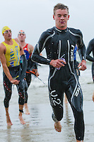 17 SEP 2011 - LA BAULE, FRA - Matt Sharp (Mulhouse Olympique Tri) leaves the water at the end of the swim during the final round of the men's French Grand Prix Series at the Triathlon Audencia in La Baule, France (PHOTO (C) NIGEL FARROW)