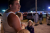 Wise, Virginia.USA.July 25, 2009..Many people sleep overnight in their cars before waiting in line to enter a Remote Area Medical (RAM) health clinic at the Wise County Fairgrounds. The free clinic, which lasts 2-1/2 days, is the largest of its kind in the nation, providing medical, dental and vision services from more than 1,400 medical volunteers.