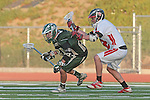 Redondo Beach, CA 05/11/10 - Travis Meersand (MC # 21) and Erik Trelenberg (PV # 2) in action during the 2010 Los Angeles Boys Lacrosse championship game, Mira Costa defeated Palos Verdes 12-10 at Redondo Union High School.