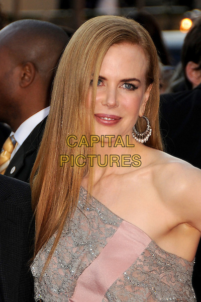 NICOLE KIDMAN.The 2009 American Music Awards held at The Nokia Theatre L.A. Live in Los Angeles, California, USA. .November 22nd, 2009.AMA AMA's headshot portrait earrings  pink grey gray lace one shoulder.CAP/ADM/BP.©Byron Purvis/AdMedia/Capital Pictures.