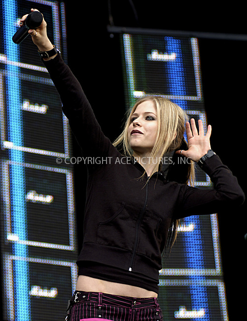 Avril Lavigne at 95.8 Capital FM's Party in the Park 2004. Hyde Park, London, 11 July 2004.  ..FAMOUS.PICTURES AND FEATURES AGENCY.tel  +44 (0) 20 7731 9333.fax +44 (0) 20 7731 9330.e-mail info@famous.uk.com.www.famous.uk.com.FAM13212