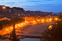The beach in the village. Collioure. Roussillon. France. Europe. In the evening with illumination and street lights.