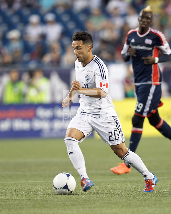 Vancouver Whitecaps FC midfielder Davide Chiumiento (20) on the attack. In a Major League Soccer (MLS) match, the New England Revolution defeated Vancouver Whitecaps FC, 4-1, at Gillette Stadium on May 12, 2012.