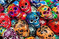 Colorful hand painted skulls (Calaveras) are sold on the market during the Day of the Dead holiday in Mexico City, Mexico, 29 October 2016. Skulls, skeletons and the other death symbols are used to adorn graves, altars and offerings during the Day of the Dead (Día de Muertos). A syncretic religious holiday, combining the death veneration rituals of the ancient Aztec culture with the Catholic practice, is celebrated throughout all Mexico. Based on the belief that the souls of the departed may come back to this world on that day, people gather at the gravesites in cemeteries, praying, drinking and playing music, to joyfully remember friends or family members who have died and to support their souls on the spiritual journey.