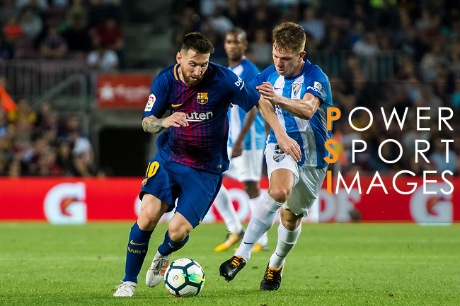 Lionel Andres Messi (l) of FC Barcelona fights for the ball with Esteban Rolon of Malaga CF during the La Liga 2017-18 match between FC Barcelona and Malaga CF at Camp Nou on 21 October 2017 in Barcelona, Spain. Photo by Vicens Gimenez / Power Sport Images