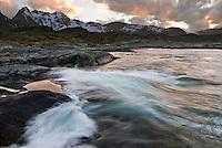 Waves crash over rocky coastline near Stamsund, Lofoten Islands, Norway