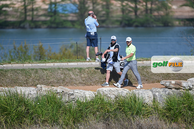 Tyrrell Hatton (ENG) makes his way around the lake to the green on 11 during day 1 of the WGC Dell Match Play, at the Austin Country Club, Austin, Texas, USA. 3/27/2019.<br /> Picture: Golffile | Ken Murray<br /> <br /> <br /> All photo usage must carry mandatory copyright credit (© Golffile | Ken Murray)