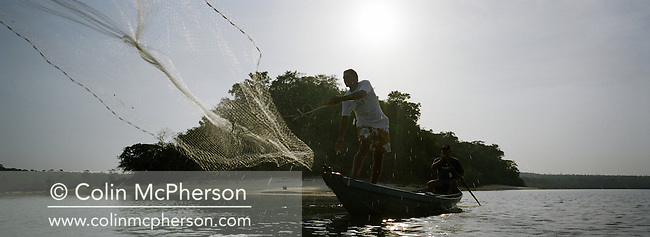 A fisherman casts his net into the waters of the Tapajos river at dawn as he tries to catch the rainbow bass, or tucunare. This was the most popular choice of fish for local dishes but catch numbers declined due to a severe drought in the Amazon and the effects of deforestation on river habitats. The rainforest was cleared by illegal logging and burning for cattle ranching and growing soy beans for export..