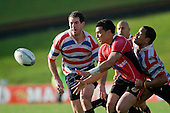 Sherwin Stowers gets the ball away as Mike Pehi makes the tackle. Air New Zealand Air NZ Cup warm-up rugby game between the Counties Manukau Steelers & Tasman Mako's, played at Growers Stadium Pukekohe on Sunday July 20th 2008..Counties Manukau won the match 30 - 7.