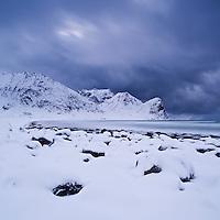 Winter storm over snow covered beach, Unstad, Lofoten islands, Norway